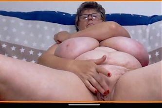 Granny Catherine with monster boobs shows pussy